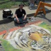 A street chalk art mural of a Tiger for Earth Day. Chalk art by Eric Maruscak.