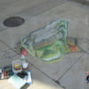 A street chalk art mural of a monster under the sidewalk. 3d street art by chalk artist Eric Maruscak.