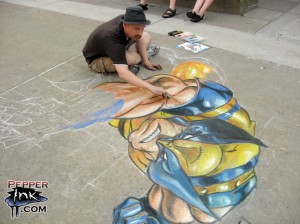 A chalk art drawing of Wolverine from Marvel Comics. Original illustration by Joe Madureira, street art by Eric Maruscak.