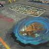 A Bioshock Chalk Art Mural made at the Wizard World Chicago Convention in 2007 for the release of the video game featuring the Bioshock Logo and a Big Daddy. Chalk art by illustrator Eric Maruscak, Bioshock video game by 2K Games.