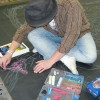 Illustrator Eric Maruscak makes a giant chalk art mural at the 2009 Big Apple Con in New York City. He recreated a Joe Quesada Spider-Man and Jim Lee Batman from a Wizard 2003 publication jam cover.