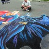 Illustrator Eric Maruscak recreates an Alex Ross painting of DC Comics Batman and Superman at an outdoor street painting festival in Upstate New York.