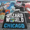 Wizard World's first ever chalk art mural at the 10th Anniversary Chicago Show in the Summer of 2006. A recreation of Michael Turner and Skottie Young artwork as a chalk mural by illustrator Eric Maruscak.