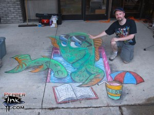 Illustrator Eric Maruscak makes a 3D anamorphic chalk art mural at the 2010 George F Johnson Splish Splash Reading Bash event.