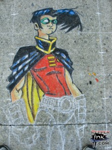 Illustrator Eric Maruscak makes a chalk art mural at the 2007 George F Johnson Library street art class. Artwork of Robin from DC Comics Teen Titans, original art by Scottie Young.