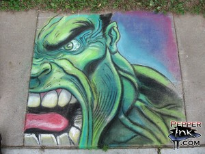 Illustrator Eric Maruscak makes a chalk art mural at the 2008 George F Johnson Library street art class. Artwork of The Incredible Hulk from Marvel Comics, original art by Ed McGuinness.