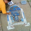 Illustrator Eric Maruscak makes a 3D anamorphic chalk art mural at the 2010 George F Johnson Library street art class.