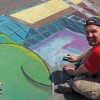 Illustrator Eric Maruscak makes a 3D anamorphic chalk art mural at the 2010 July Festival in Binghamton, NY. This was a sidewalk art tribute to Cartoonist Johnny Hart who created the comic strip B.C.