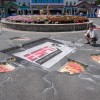 Artist and Illustrator Eric Maruscak works on a 3D chalk mural for the ESPN Summer Picnic at Lake Compounce Amusement Park in Bristol, Connecticut.