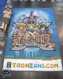 Artist and Illustrator Eric Maruscak creates a 20th Anniversary Yu-Gi-Oh! mural for toonzaki.com at the 2010 New York Comic Con and New York Anime Festival.