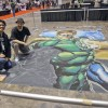 Illustrator and chalk mural artist Eric Maruscak works on a Green Lantern chalk mural based from an Ivan Reis illustration at the 2011 C2E2 Convention in Chicago, Illinois.