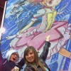 Eric Maruscak, artist from pepperink.com, creates a giant Madoka Magica chalk mural for Aniplex at the Anime Central Convention in Rosemont, Illinois.