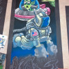 Illustrator Eric Maruscak makes progress on the astronaut chalk drawing.