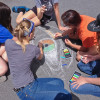 Students work on their chalk art as teacher Eric Maruscak helps with the process.