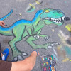 A students dinosaur chalk art comes together very nicely.