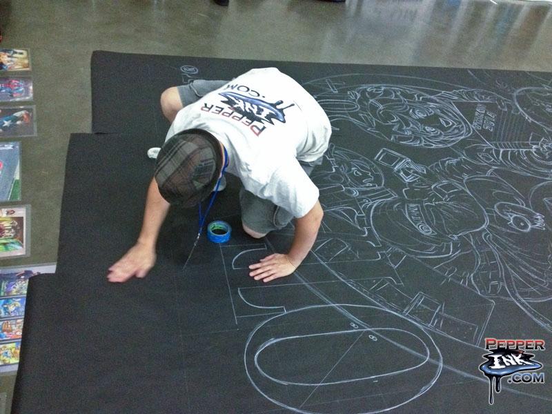 Assembling the Otakon chalk art, original by Yusuke Kozaki, chalk art by illustrator Eric Maruscak.