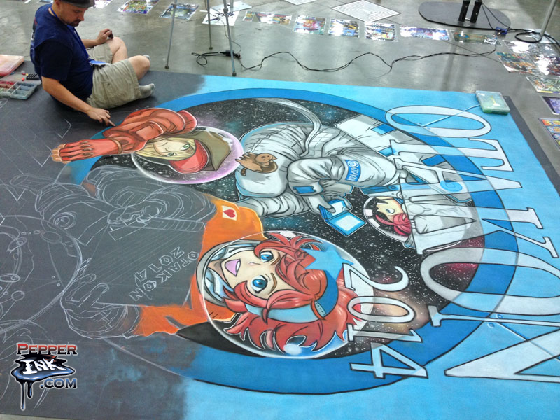 Illustrator Eric Maruscak makes progress on the 2014 Otakon chalk art during day two of the show.