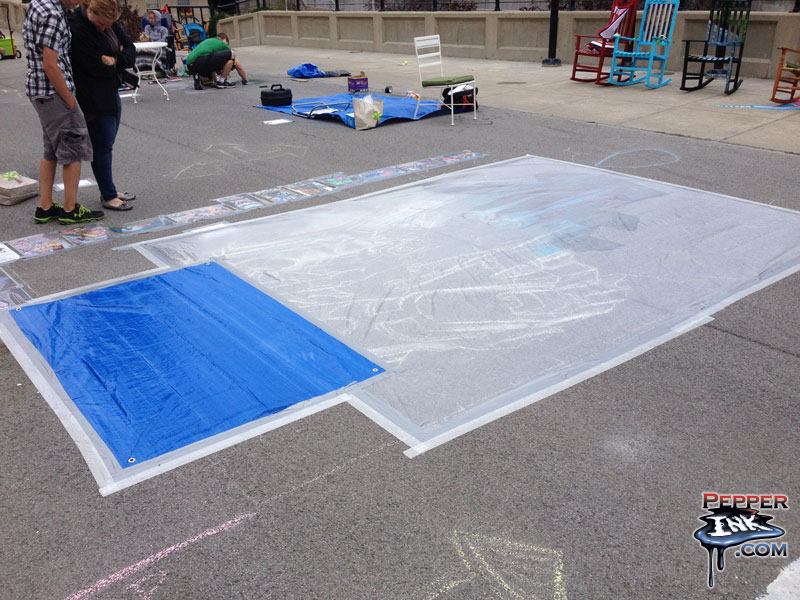 Batman chalk art under tarps at the end of day one, by illustrator Eric Maruscak.