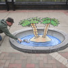 3D Palm Tree and Island optical illusion chalk art by illustrator Eric Maruscak.
